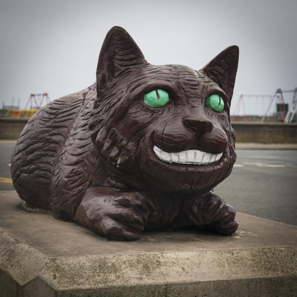 Photos of Alice and Wonderland Wooden Statues in Llandudno as part of the White Rabbit Trail