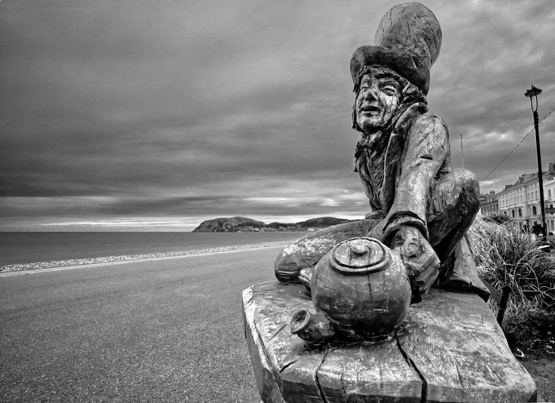 Black & White Photo of Mad Hatter Statue on the Llandudno Prom in North Wales. Taken on a Welshot Imaging Photographic Academy Event by Victoria smith