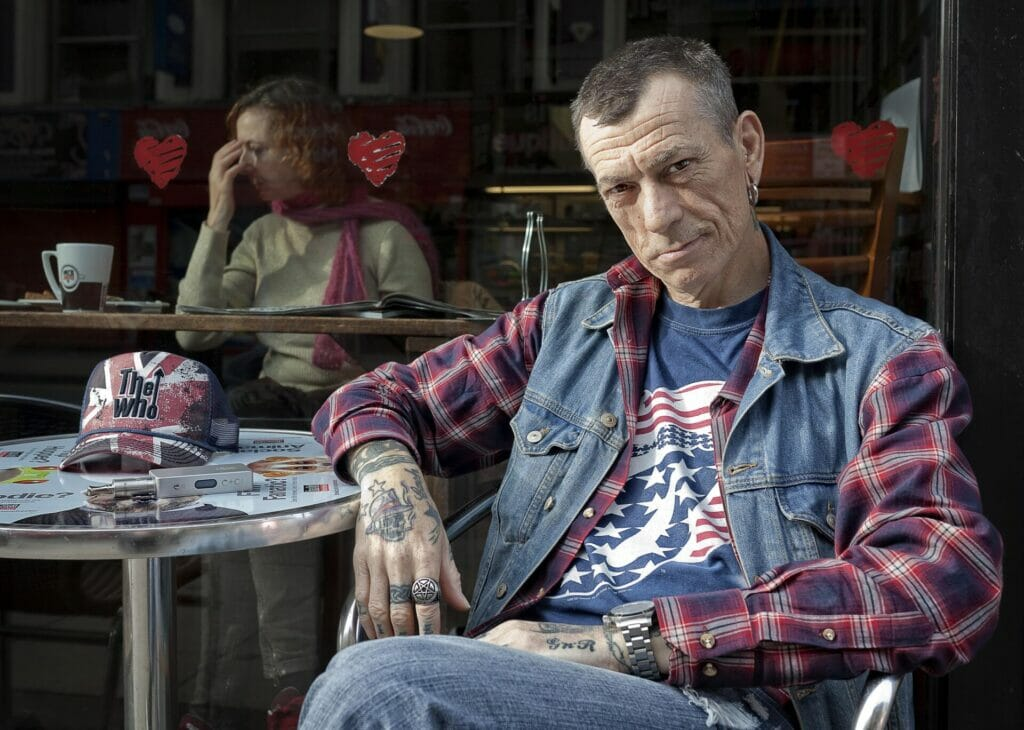 Coloured Photo of a Man sitting outside a cafe
