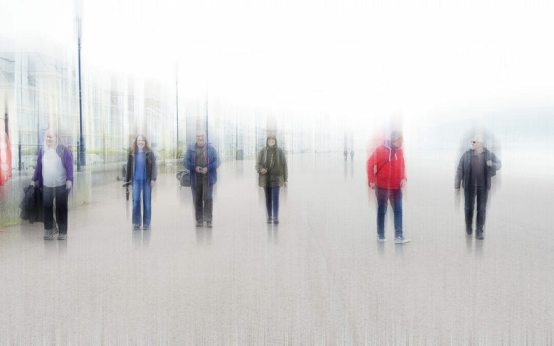 A blurred image (intentional camera movement) of a group of people socially distancing walking along the Llandudno Prom in North Wales. Taken on a Welshot Photographic Workshops and Events Day