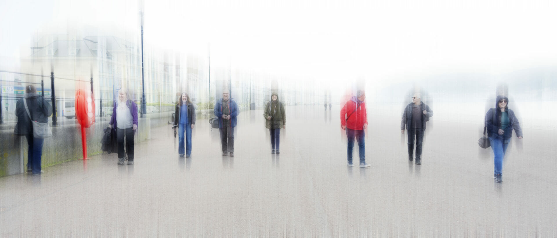 A blurred image (intentional camera movement) of a group of people socially distancing walking along the Llandudno Prom in North Wales. Taken on a Welshot Photographic Workshops and Events