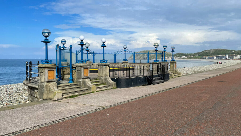 Photo of the bandstand on Llandudno prom in North Wales with blue sky and white clouds