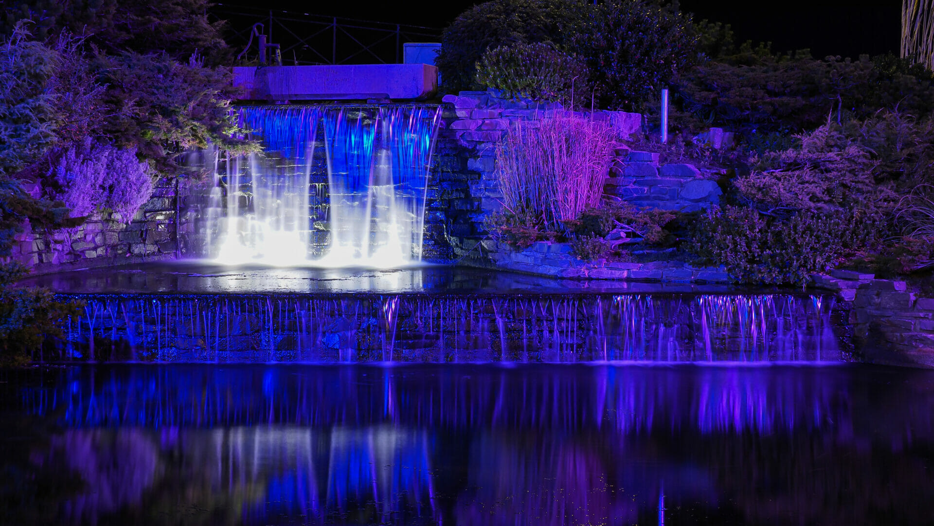 Photo of a man-made water feature in Rhyl, Norht Wales - shot at night in low-light with the coloured lights displaying