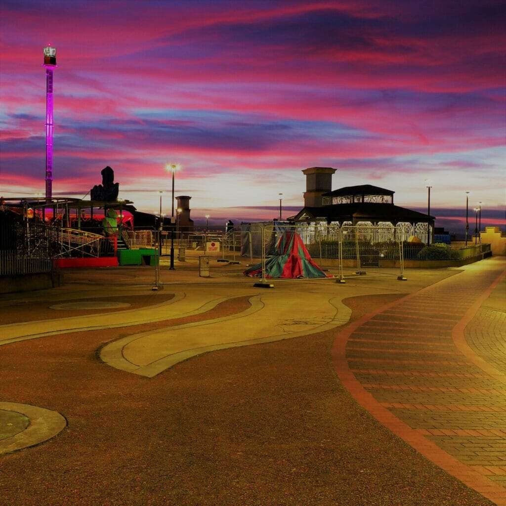 Photo of the Children's playground in Rhyl, North Wales - Taken in low-light with the sun going down and showing a red / purple sky