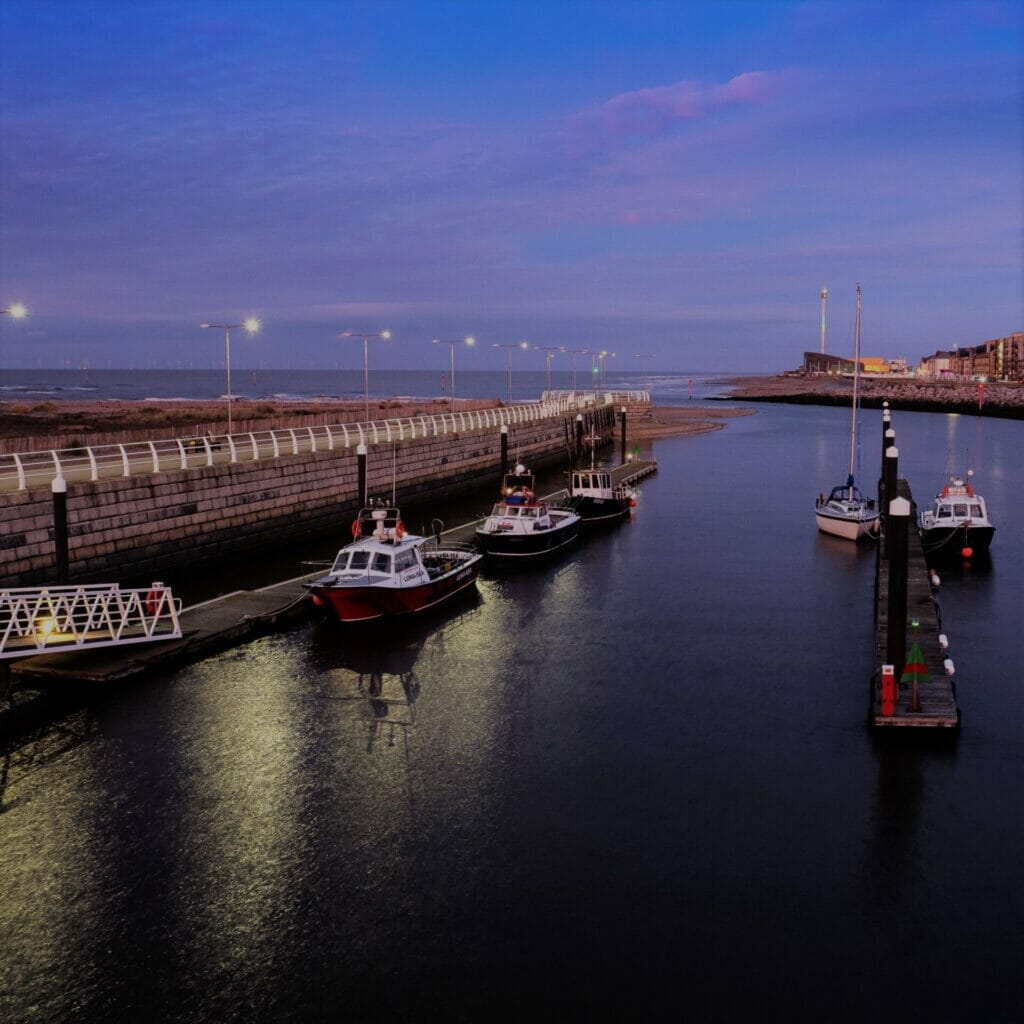 Photo taken at night of the new harbour in Rhyl, North Wales with fishing boats - taken on a Low-Light and Long Exposure Photography - Rhyl - Roving Academy Evening workshop with Welshot
