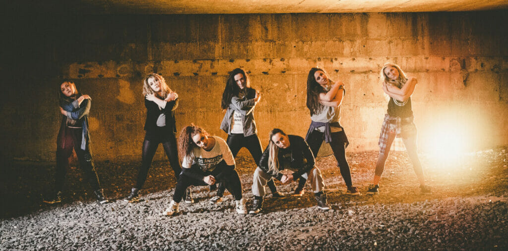 Colour Photo of a group of girls from the Street Dance Troupe Autonomy in Chester - Dancing on Location Off Camera Flash Photography at the Welshot Photographic Academy Evening
