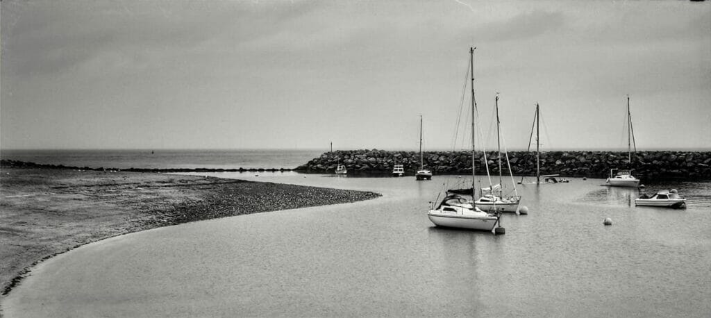 Black and White Photo of sail boats in the Rhos on Sea harbour in North Wales