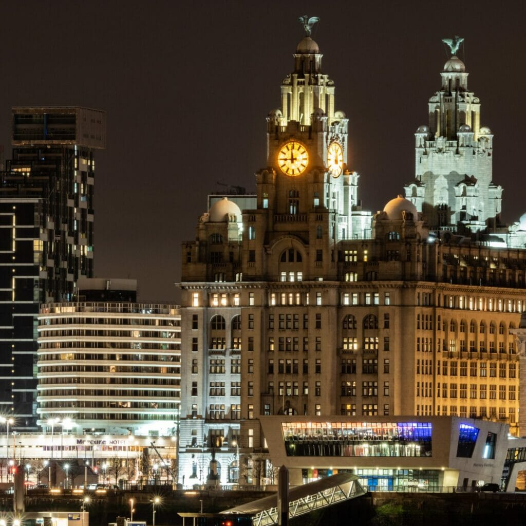 Photo taken at night of the Liverpool Skyline showing historic buildings shot from Birkenhead Liverpool Skyline & Low-Light Photography