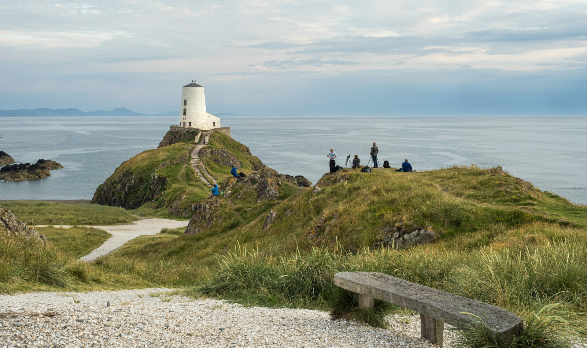 Photo of a group of photographers on a Welshot Photographic Academy Event taking photos of the old lighthouse on Llanddwyn Island, Anglesey