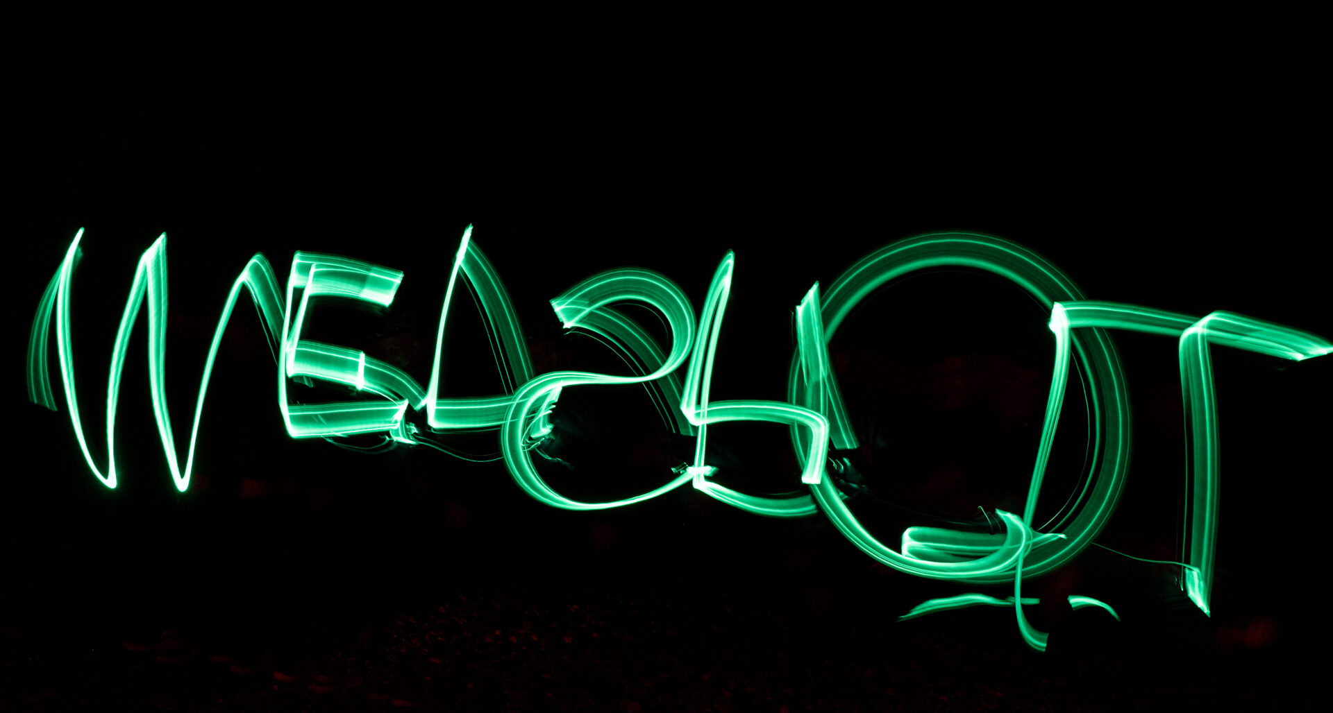 Photo of a Long Exposure with the words Welshot written with a green torch - Taken on a Welshot Photographic Workshop in North wales