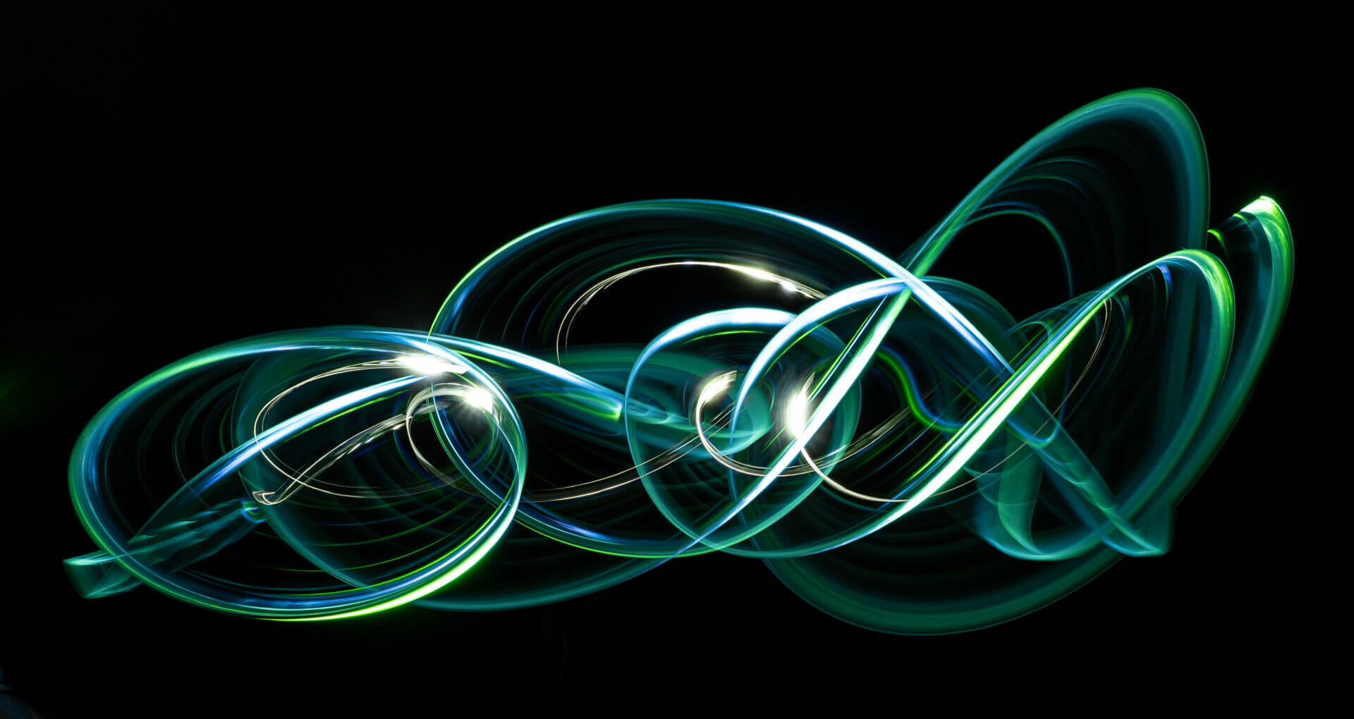 Photo made by waving a green light around in the dark to showcase the techniques for Long Exposure Photography - Light Painting Techniques - Chester Academy Evening