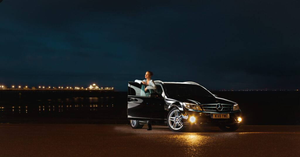 Car Photography on Location - Photo of Car on the Llandudno Prom in North Wales with a Model - Lit by a single light - Taken on a Welshot Photographic Academy Car photography workshop