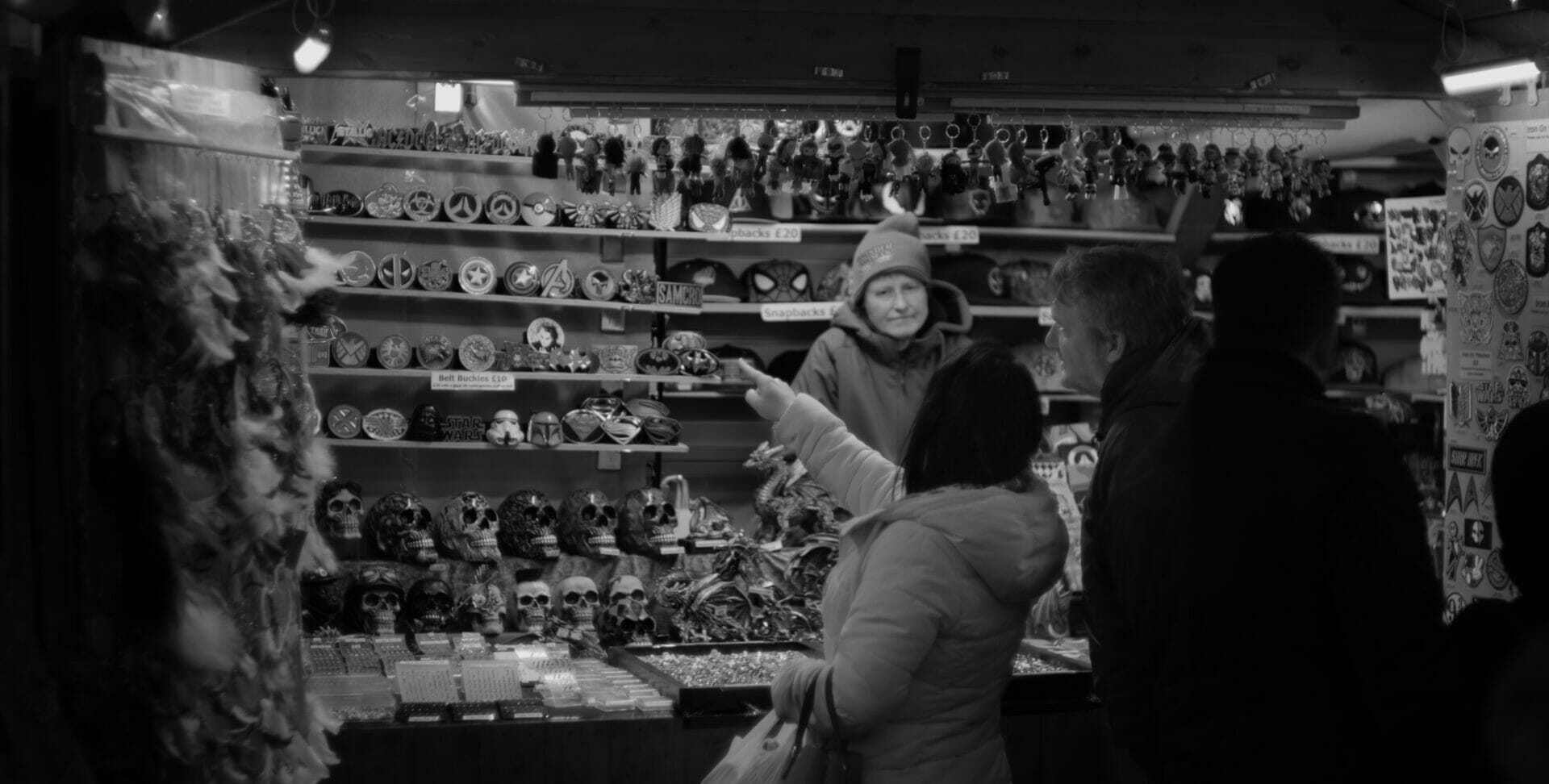 Black and white photo of person shopping at the Chester Christmas Markets