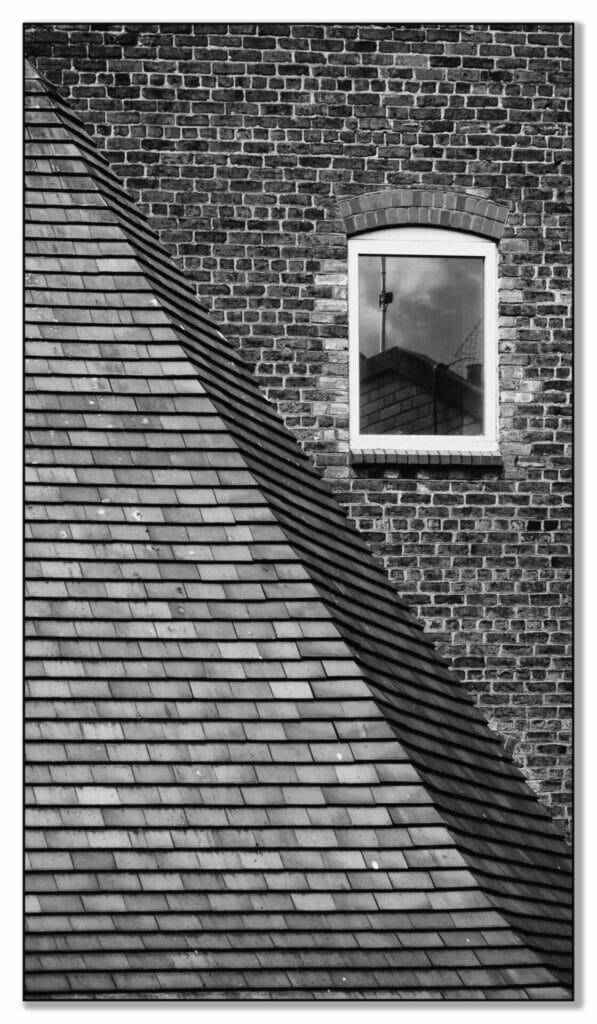 Black and White Photo showing architectural details from along the Chester City Walls.