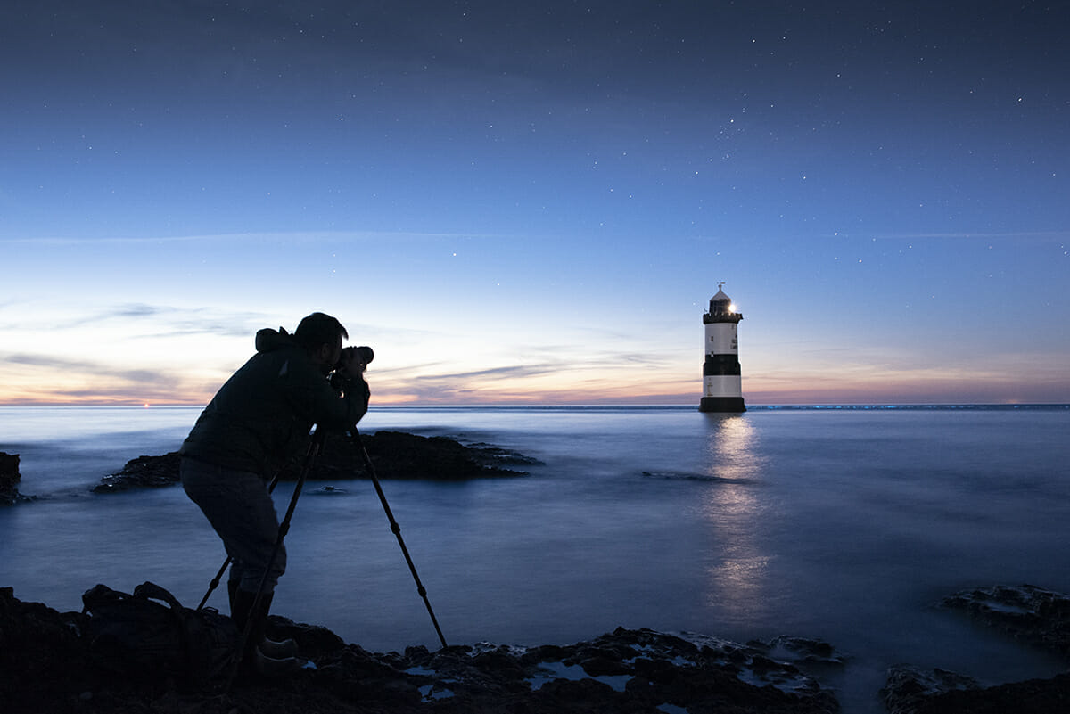 Photo of a Photographer learning How To Photograph the Night Sky at Penmon Point Anglesey with the Welshot Photographic Academy